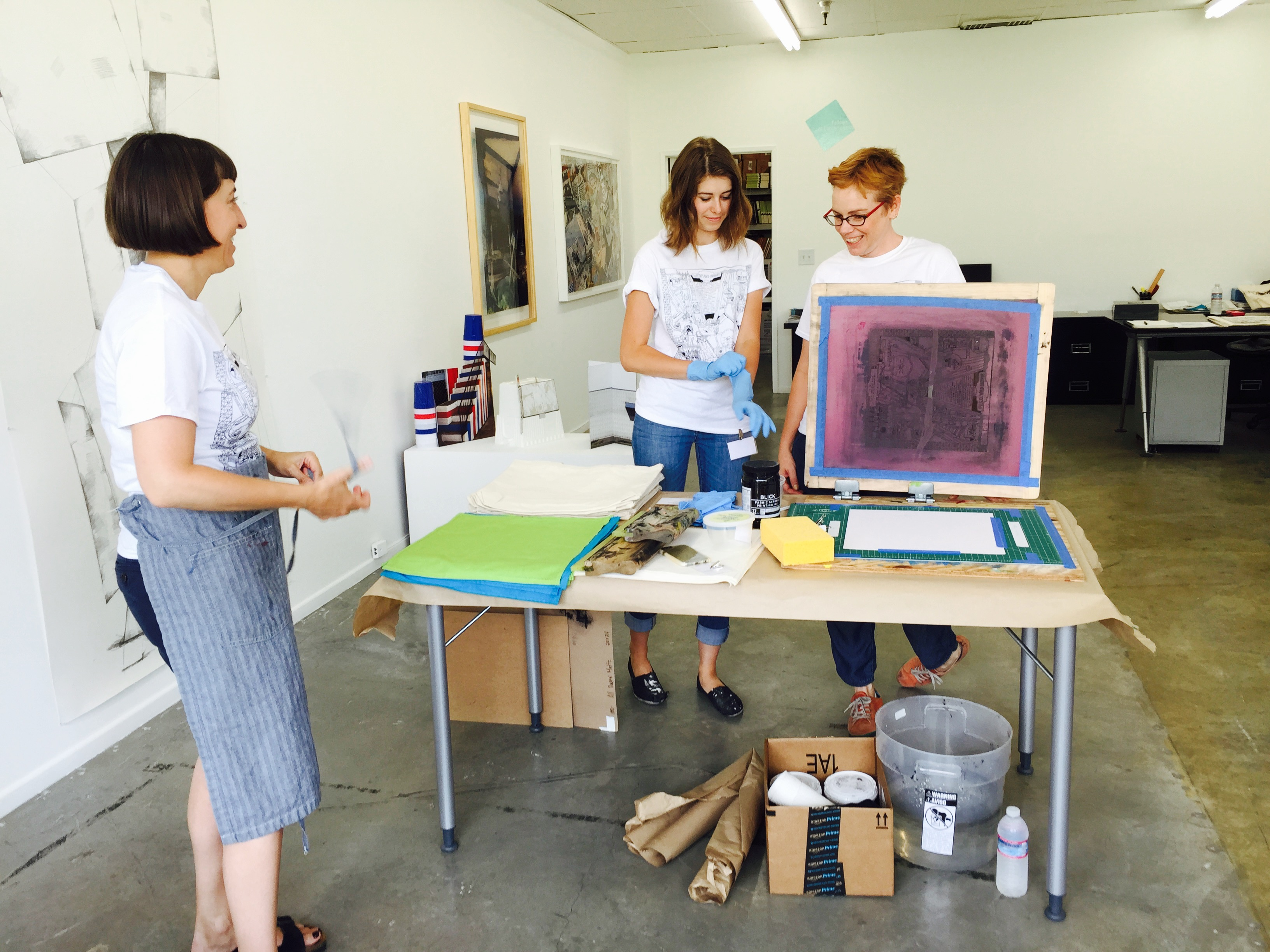 Witty and Urbane screen printing workshop: left to right Melissa Manfull, Intern Julie Anderson, curator  Kristi Lippire